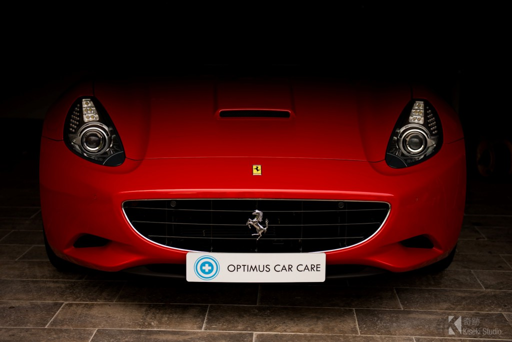 Ferrari California peeking out of a garage