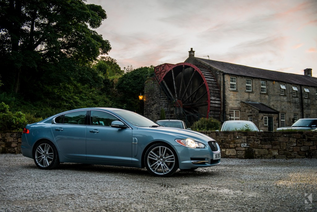 Jaguar XF-S next to a watermill