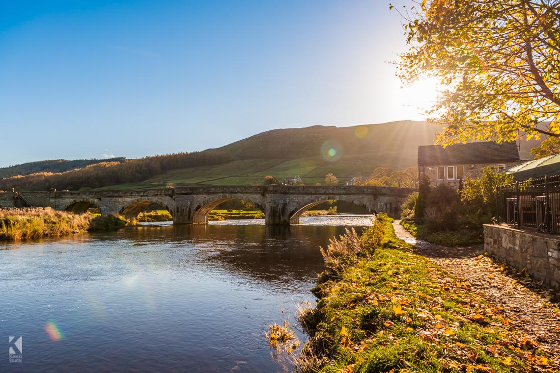 Burnsall bridge on a sunny autumn day