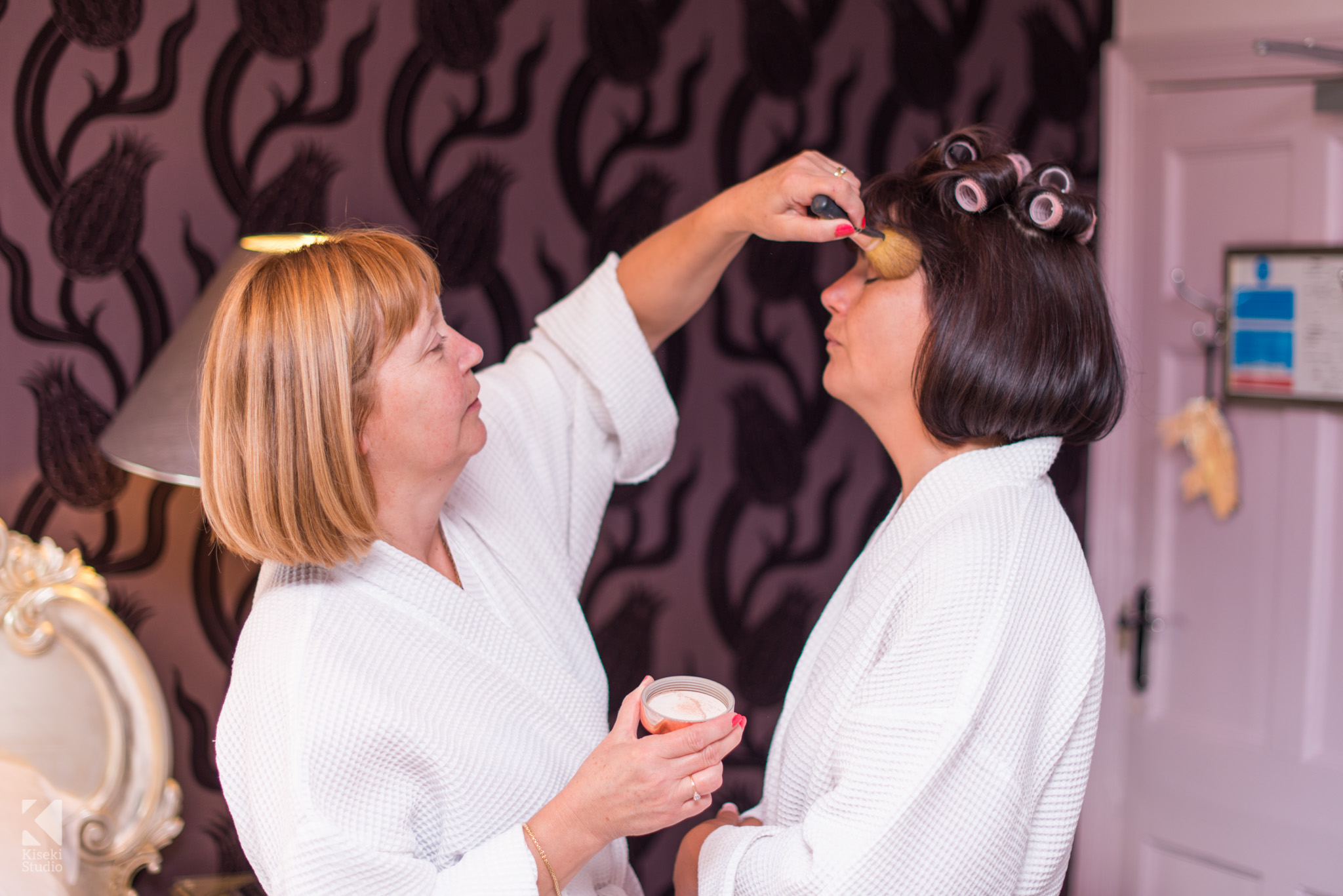 Brides sister helping her to get ready