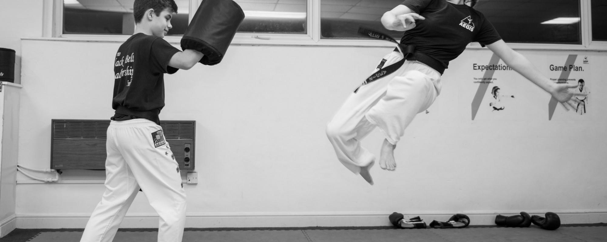 aegis-martial-arts-class-leeds-flying-kick-mid-air
