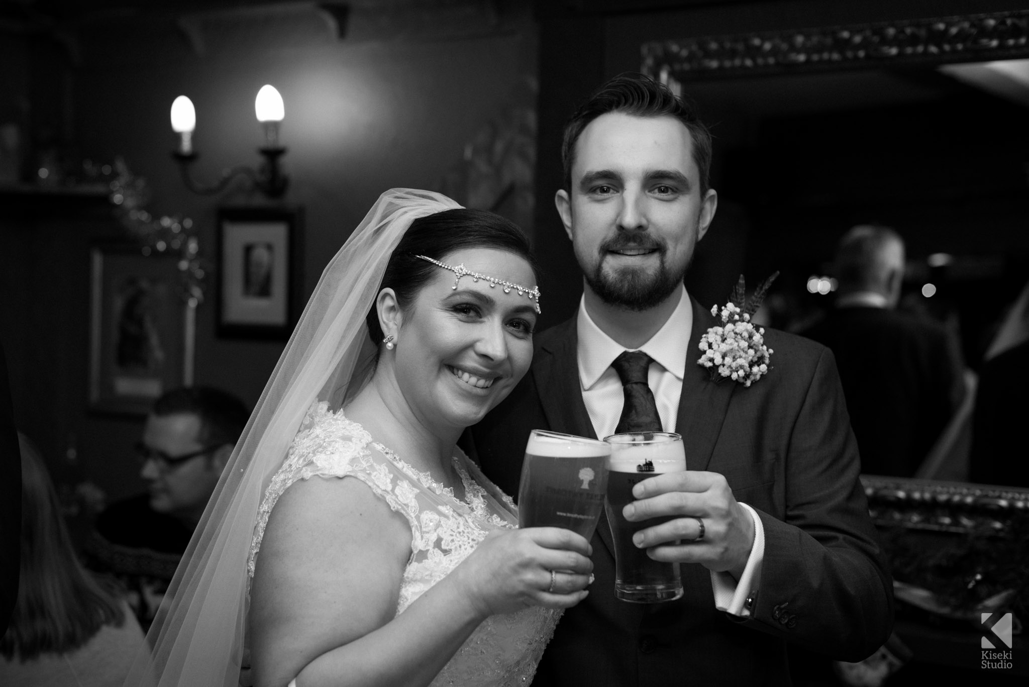 Bride and Groom having a pint in the Woolpack