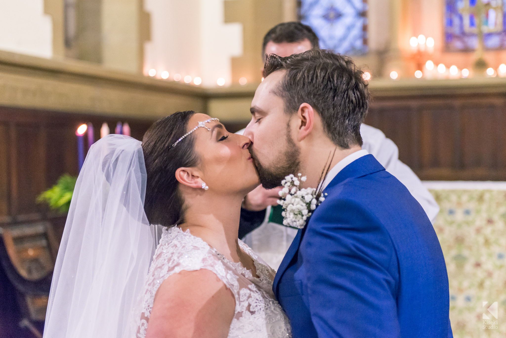 Bride and Groom kissing in the church