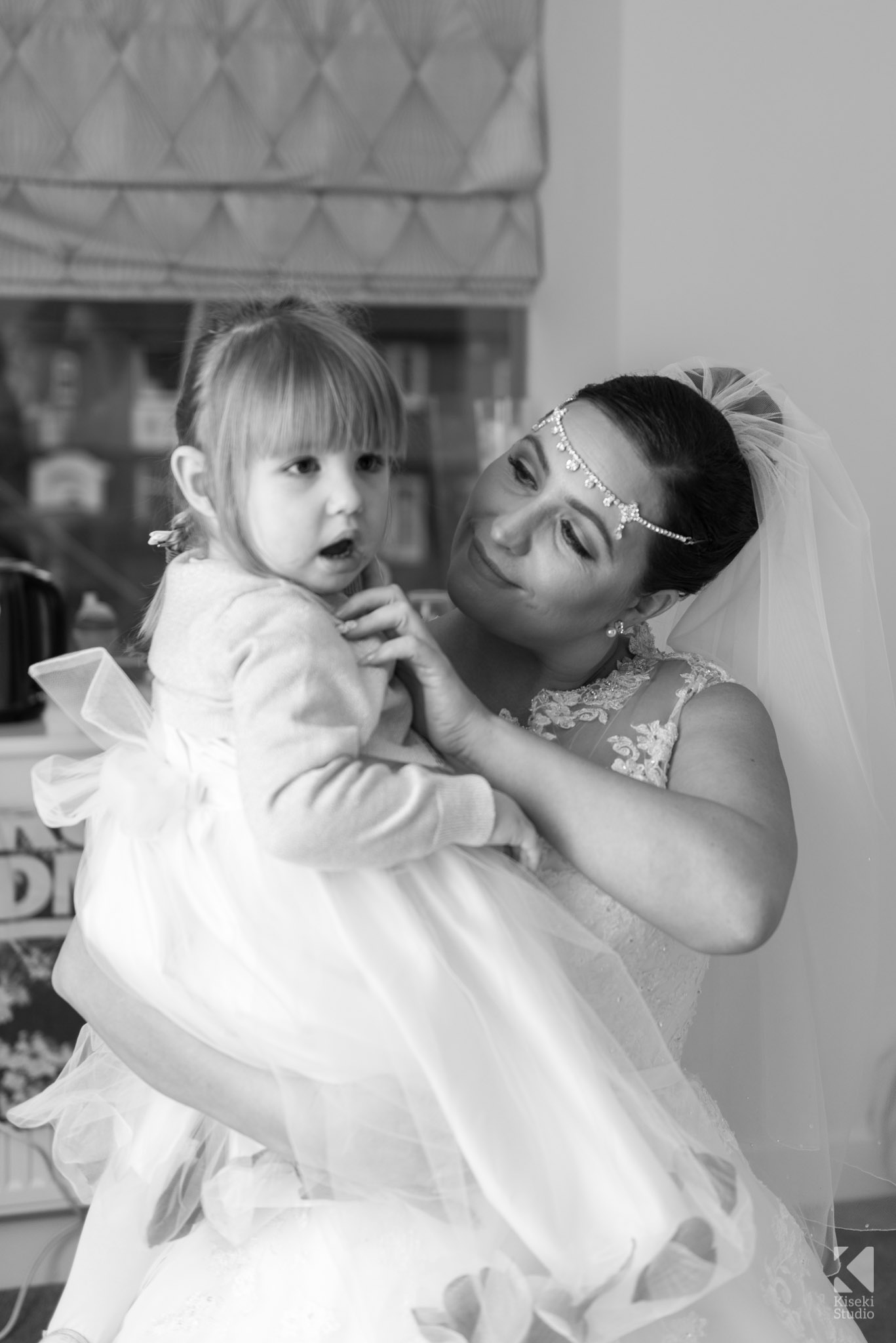 Bride and Daughter in wedding dresses