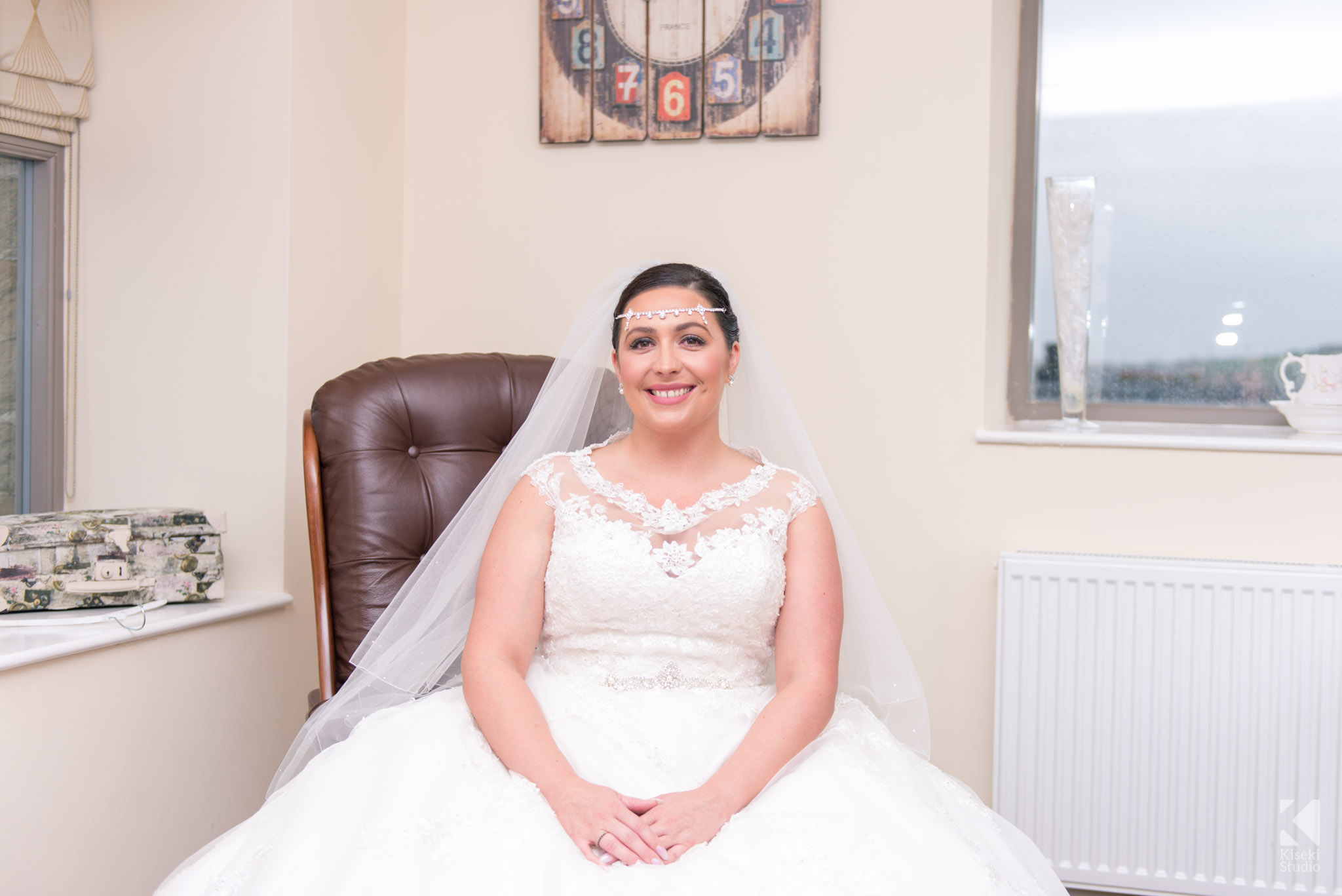 Bride sitting in the suite