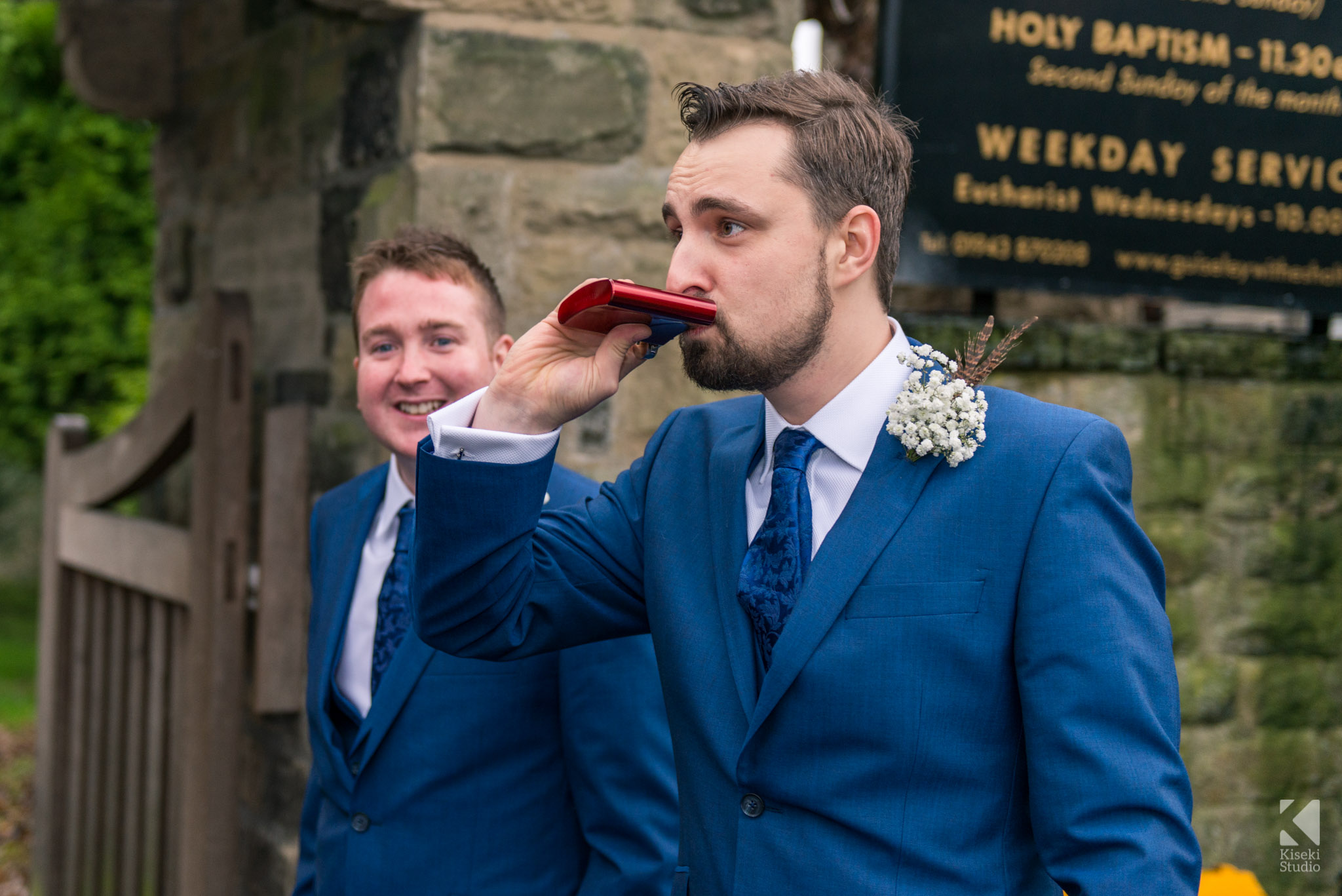 Groom having a cheeky pre-wedding drink