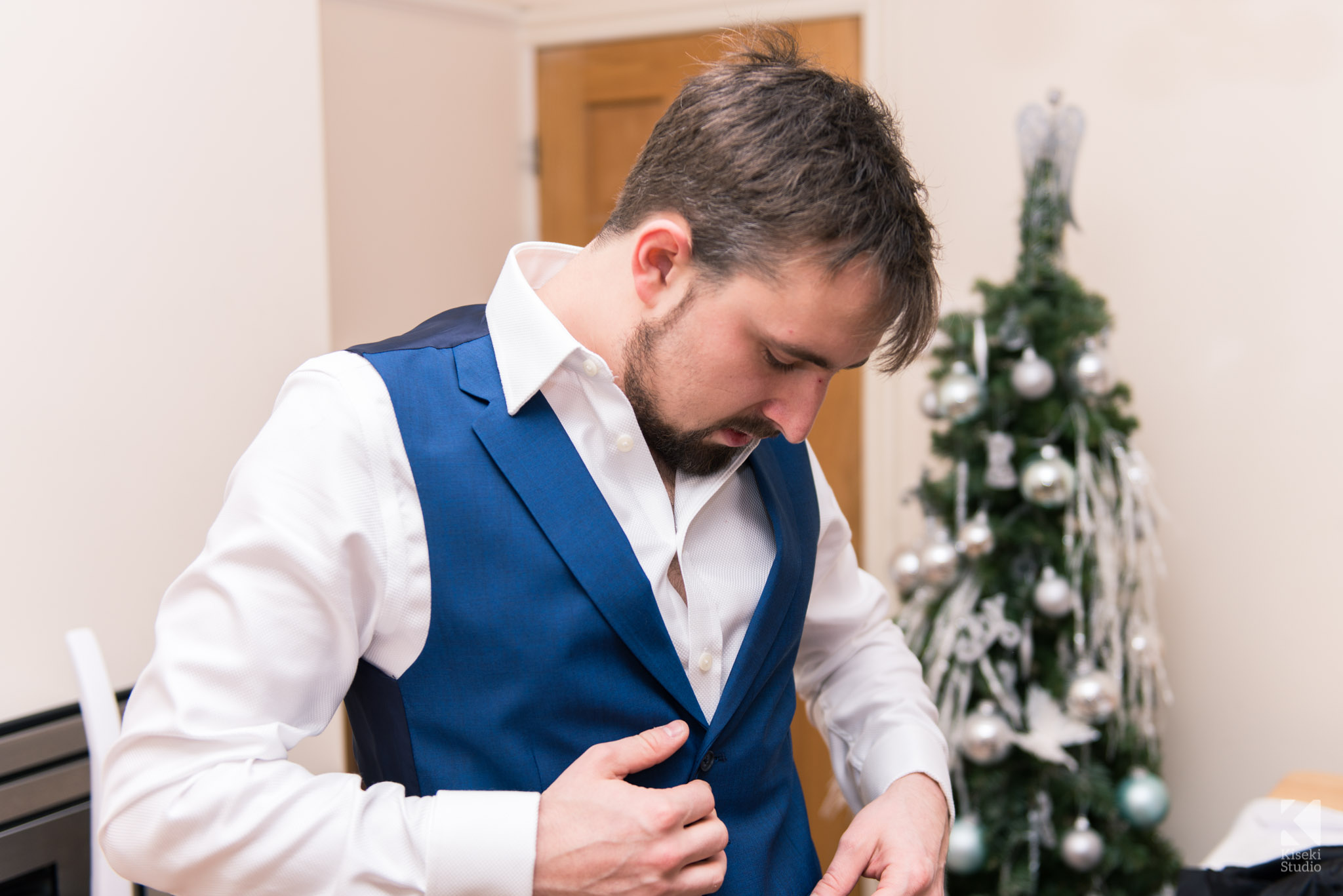 Groom preparing his suit