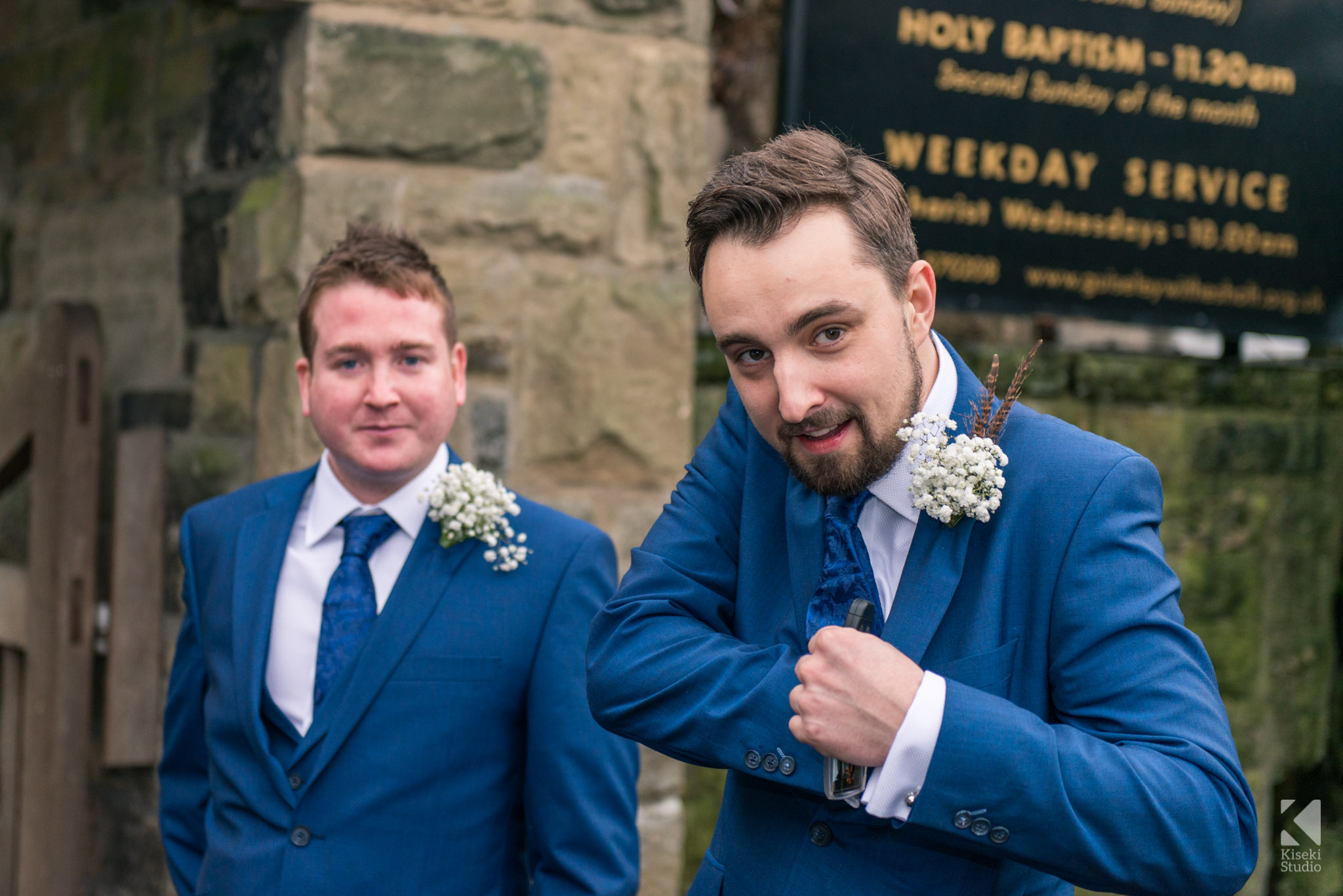 Groom reaching for his hip flask
