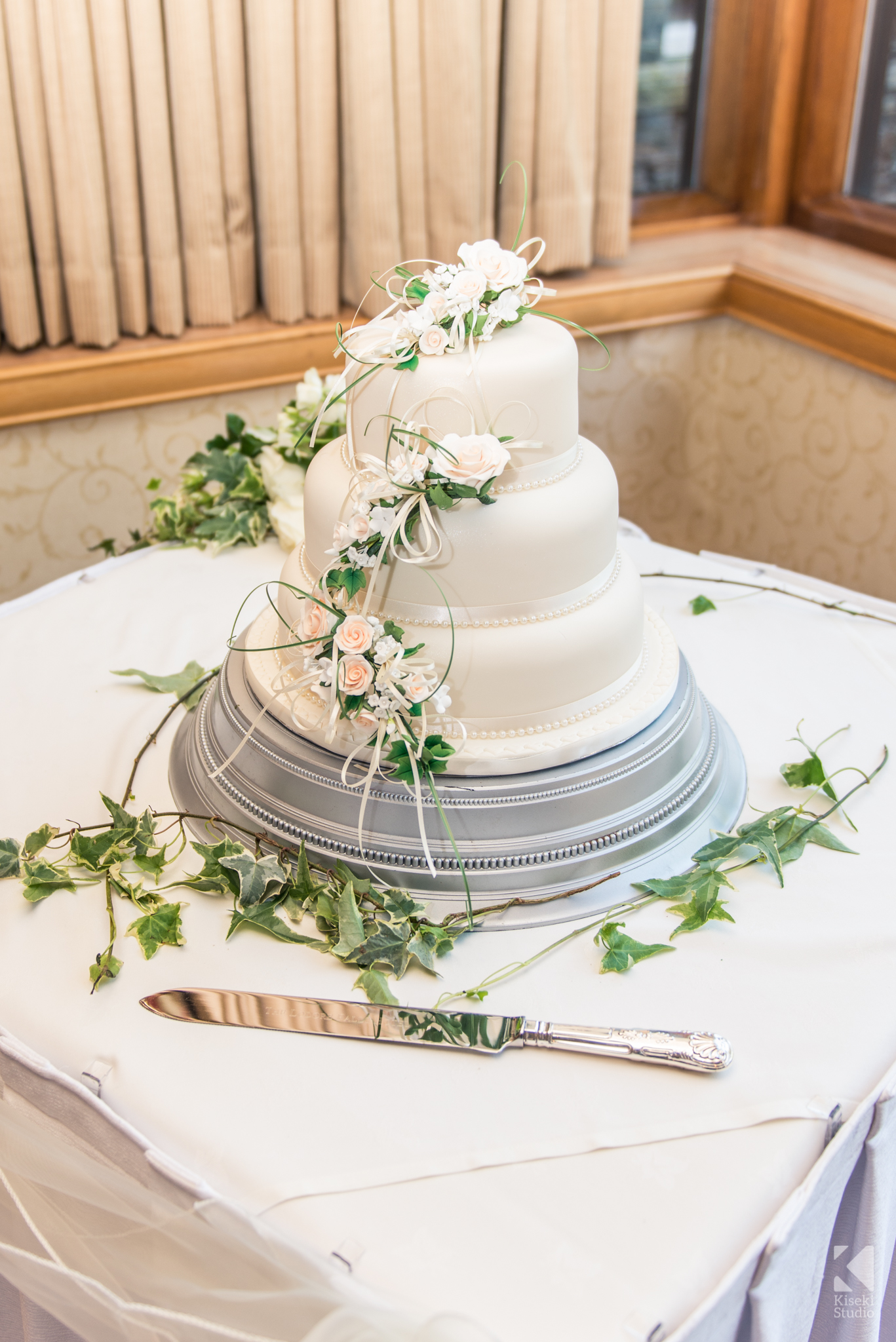 white-wedding-cake-tier-knife-fresh