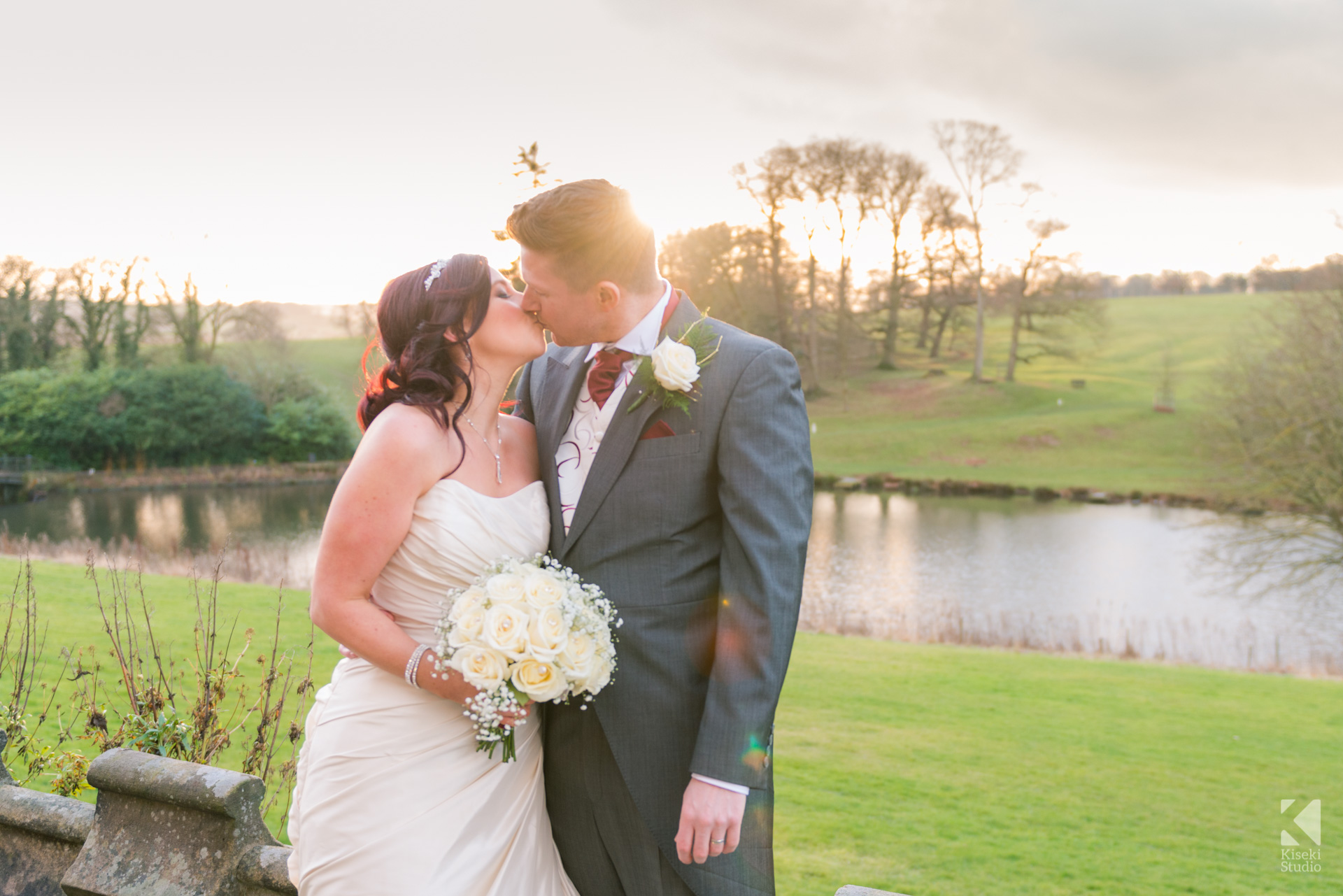 Ripley Castle Wedding - Bride and Groom kissing and sunset