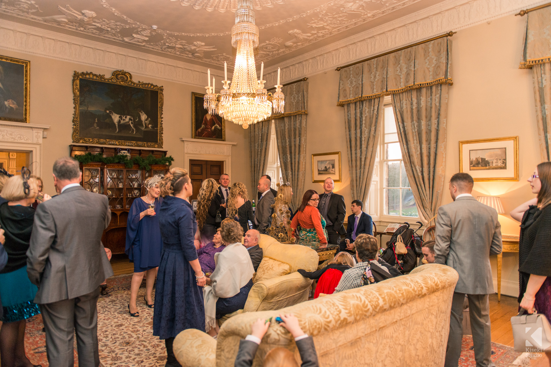 Ripley Castle Wedding - Guests enjoying a drink in the living area
